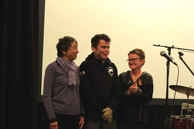 Dave Repsher's mother, Marilyn, joined he and his wife Amanda on stage at Copper Station Saturday night. It was Repsher's first public speaking event since he was burned in a Flight For Life helicopter crash.
