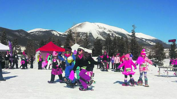 The Lil' Stompers leave the starting line for the kids snowshoe race.