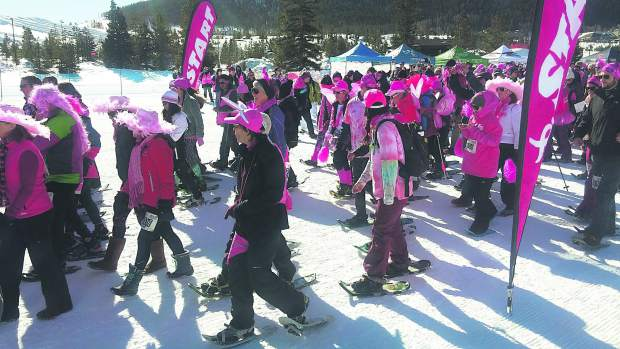 Snowshoers decked out in pink set off to raise money for breast cancer research.