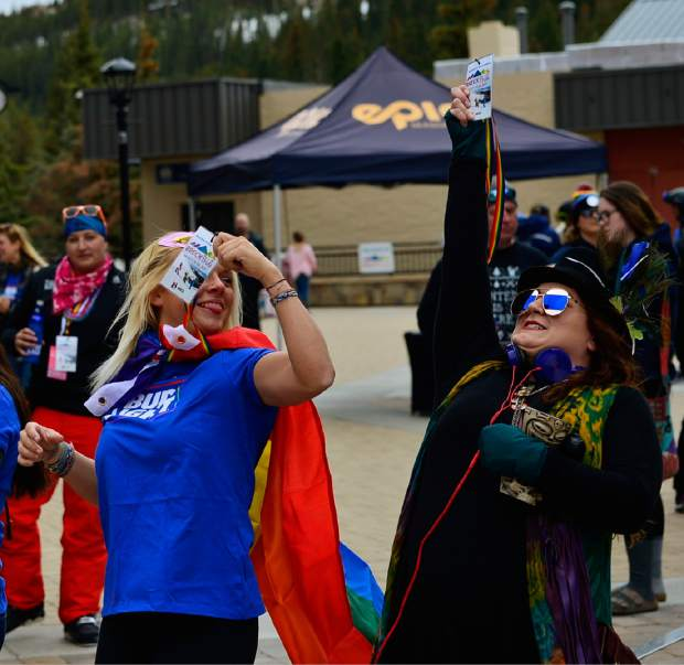 Nikki Nace and Christina Hunt wait to see if their number is called for one of the giveaways Saturday at The Village Plaza in Breckenridge for Breck Pride Week.