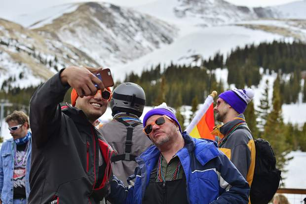 Skiers prepare to head down the mountain during the Color Run Parade on Saturday during the first-ever Breck Pride Week.