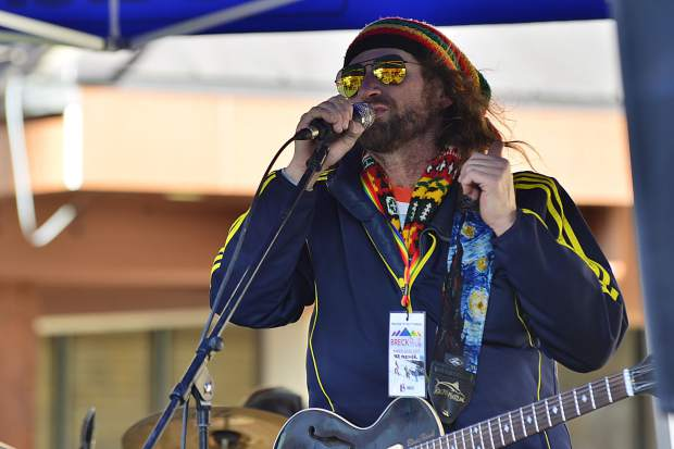 Diego Elliott of Summit County jams out with Will Abbott of Denver in the background Saturday at The Overlook restaurant before the start of the Color Run Parade at Breckenridge Ski Resort. The event was one of a number from Wednesday to today for the first-ever Breck Pride Week.