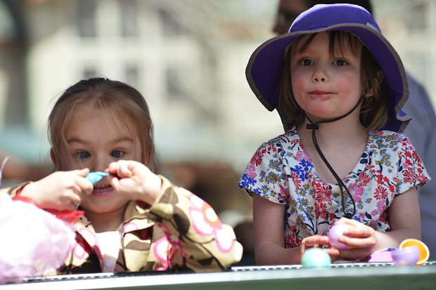 Katy McNeely and Elle Price, right, go through their haul after 2017 Easter egg hunt Sunday in Frisco.