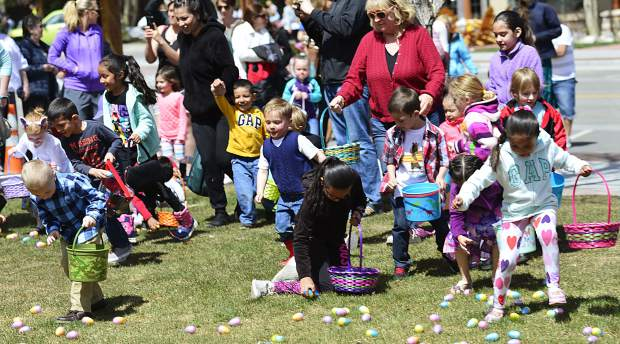 Children in the one of the older groups gather up eggs Sunday during the 2017 Easter egg hunt in Frisco.