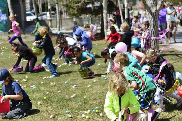 Children round up eggs Sunday during the 2017 Easter egg hunt in Frisco.