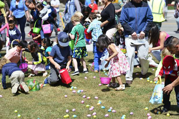 With the city putting out more than 5,000 eggs, including some filled with inspirational notes in addition to candy, children make quick work of them Sunday during the 2017 Easter egg hunt in downtown Frisco.