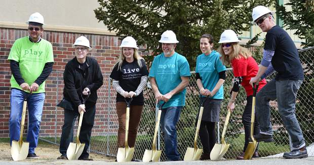 Members of the Breckenridge City Council, from left, Mike Dudick, Mark Burke, Elisabeth Lawrence, Mayor Eric Mamula, Erin Gigliello, Wendy Wolfe and Jeffrey Bergeron break ground on a $17.2 million renovation of the Breckenridge Recreation Center on Tuesday at the center. During the ground breaking, Scott Reed, the city's director of recreation, noted that the center logged 175,000 individual uses in 2016, not bad considering the city's population stands at about 4,600 people. Project completion is scheduled for 2018.