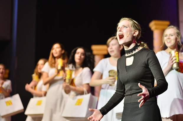 "Senior Claire Davidson performs Tuesday during a rehearsal for Summit High School's spring musical ""We Will Rock You"" at the school."