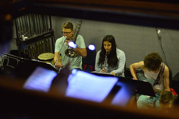 "The pit plays Tuesday during a rehearsal for Summit High School's spring musical ""We Will Rock You"" at the school."