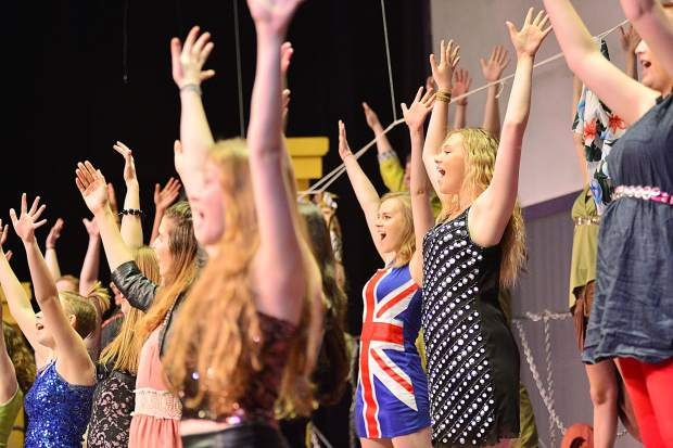 "Students perform Tuesday during a rehearsal for Summit High School's spring musical ""We Will Rock You"" at the school."