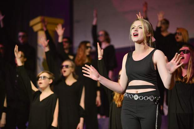 Killer Queen, played by Hannah Starnes, sings during a Tuesday rehearsal for Summit High School's spring musical