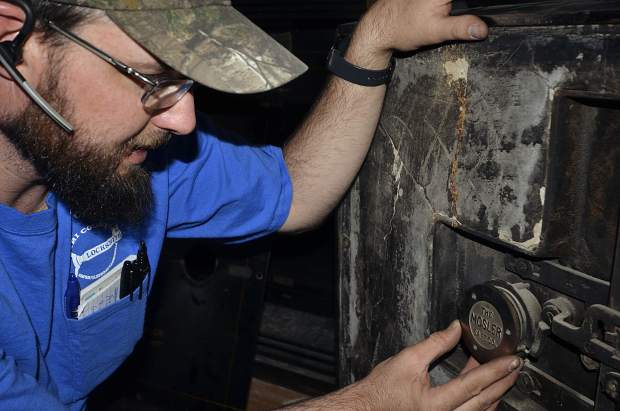 Wayne Winton, owner of Tri-County Locksmith Services, takes a look at the backside of the Post Independent's Mosler #10 safe door.