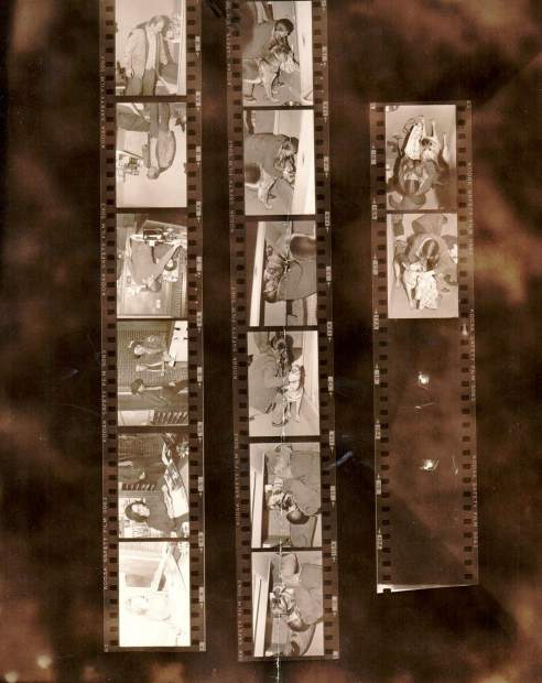 Numerous contact sheets hidden away in a safe with a forgotten combination show images from the manhunt for Ted Bundy. Several images here show tracking dogs sniffing at Bundy's shirt.