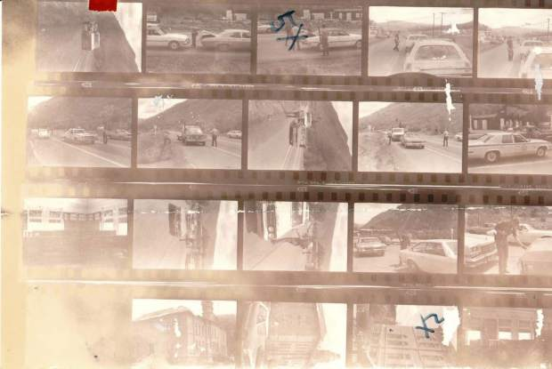 These images show armed law enforcement searching vehicles on a roadblock on Colorado 82 during the search for Ted Bundy.