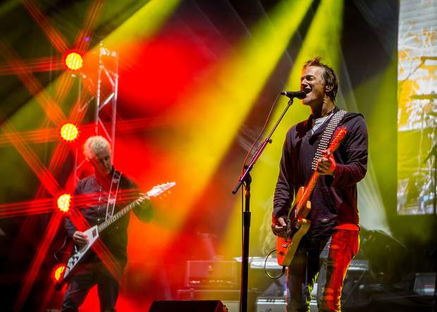 Stefan Lessard of the Dave Matthews Band, Mike McCready of Pearl Jam, Brett Scallions of FUEL and drummer Kenneth Schalk jam out Saturday in Vail during a free concert for the 123GO! Project.