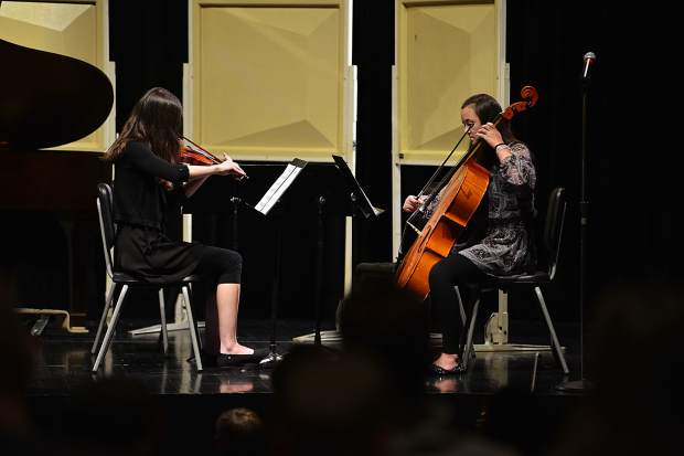"With the help of Maclean Donovan on violin, Abigail Wineland, right, performs her original composition, ""Dance of the Dragonfly,"" during the third annual Young Composers Competition Concert on Monday at Summit Middle School in Frisco."