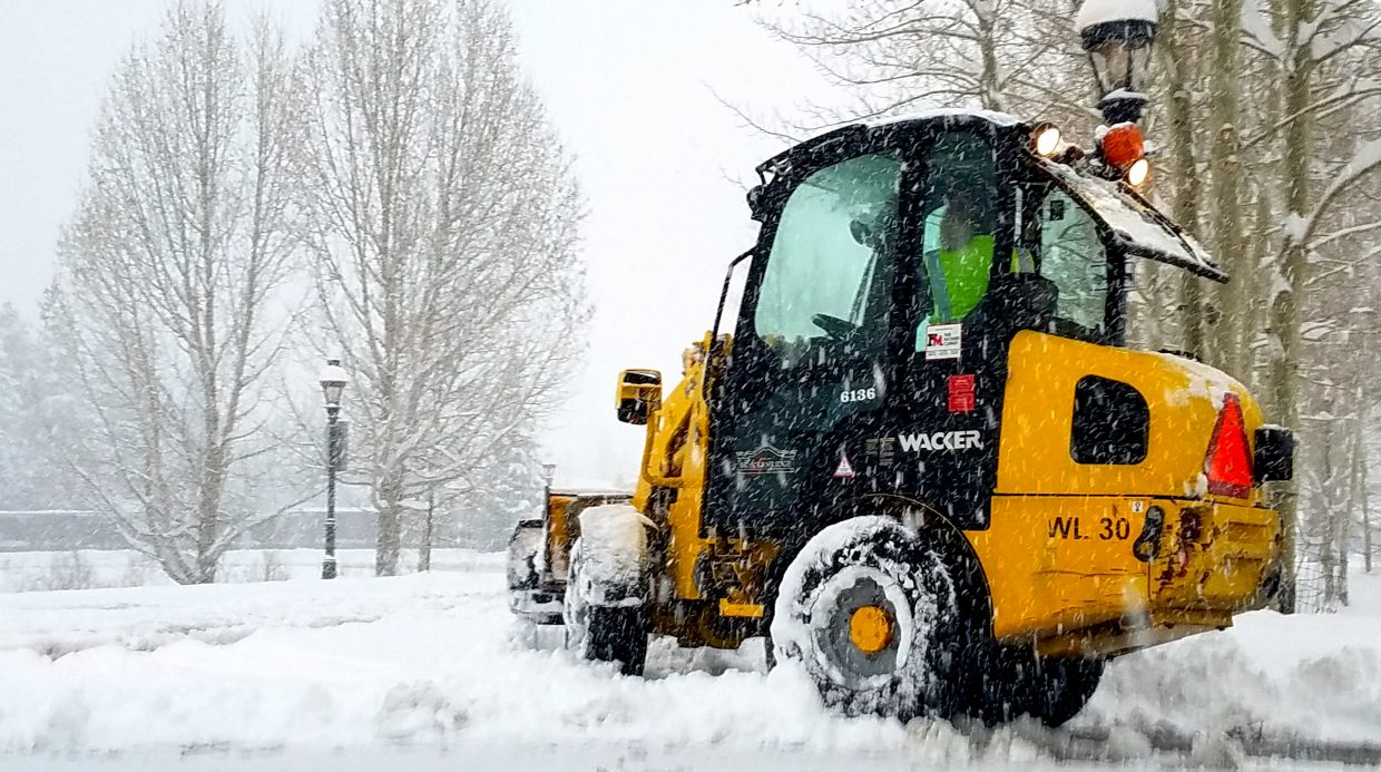 A town of Breckenridge employee clears about a foot of snow from the Breckenridge Recreation Center driveway at 7:30 a.m. on May 18. By 9 a.m. the driveway had nearly refilled with another 6 inches of soft, wet, surprise May powder.