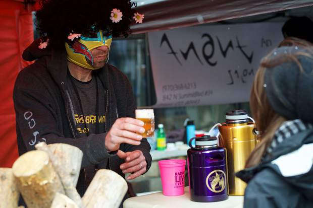 A representative of Bonfire Brewing, based in Eagle, pours a beer April 7 at the Spring Beer Festival in Breckenridge.