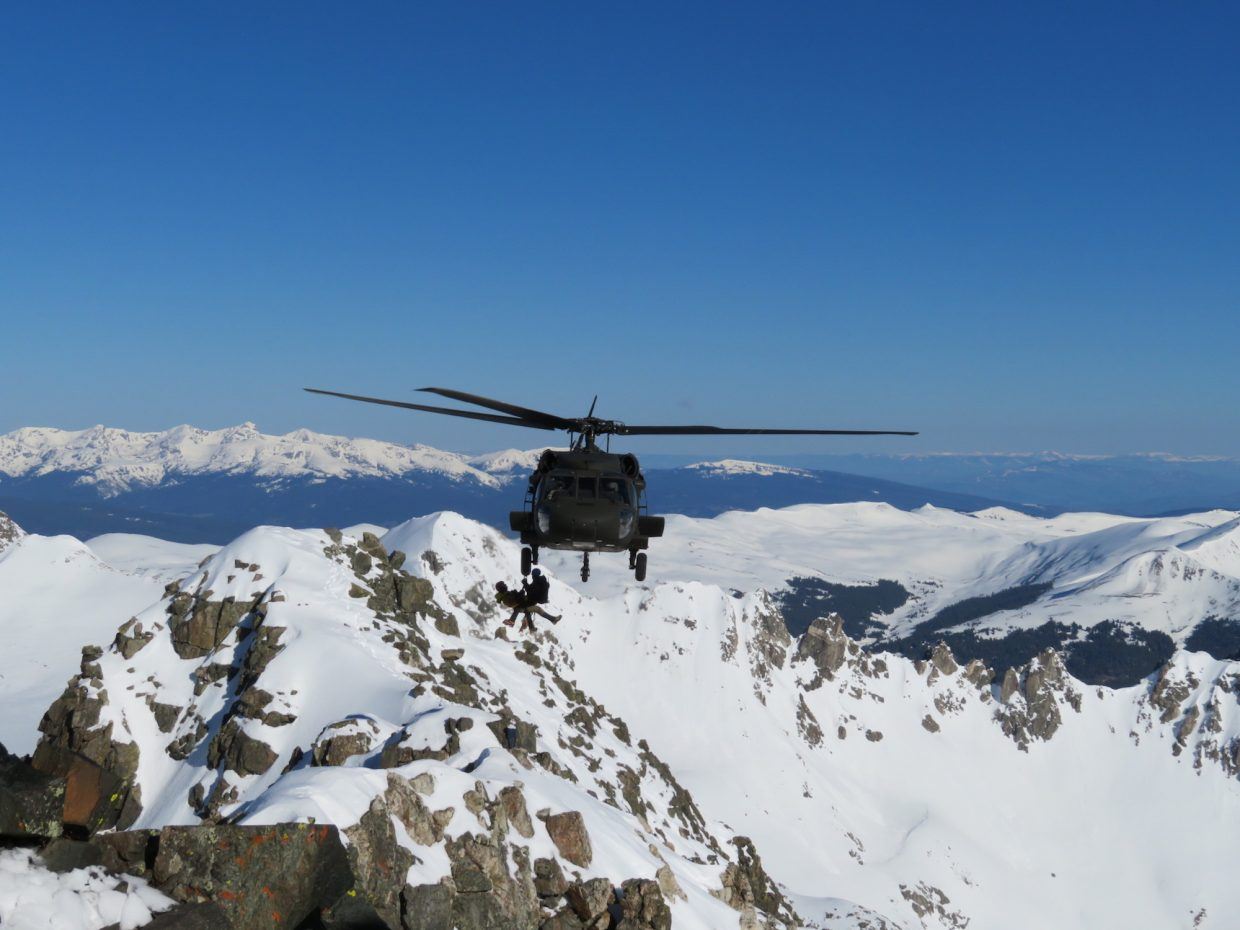 A Blackhawk helicopter from the Army National Guard's High-Altitude Aviation Training Site in Eagle approach Quandary Peak, where two climbers were stranded on Sunday evening.