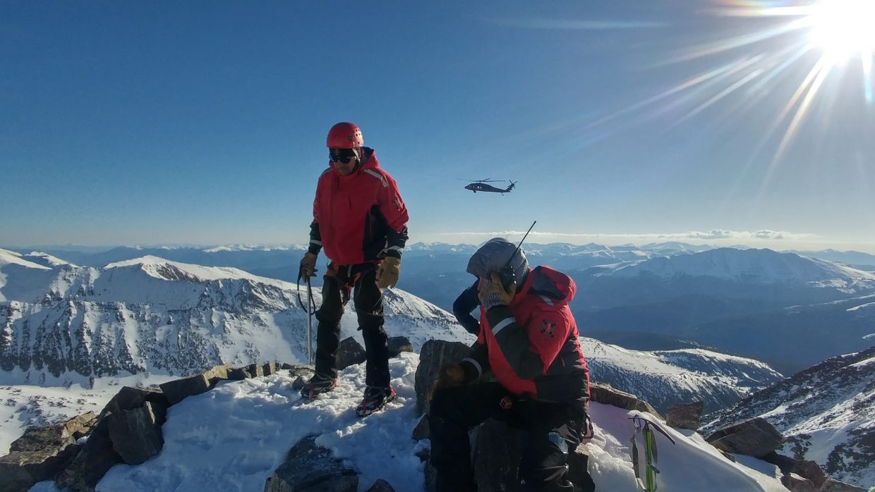 Members of the Summit County Rescue Group wait for a Blackhawk helicopter to arrive and aid in the rescue of two climbers who were stuck near Quandary Peak. The climbers were recovered on May 29, Monday morning.