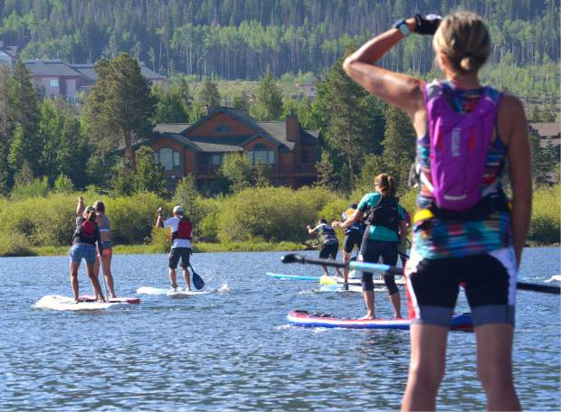 Scenes from the opening SUP leg on Lake Dillon at the 2016 Frisco Triathlon. SUP instructors suggest yoga and core training to prepare for flat water and whitewater SUP this summer.