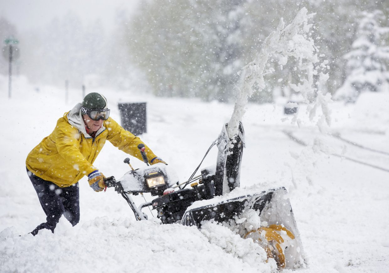 Summit County resident Todd Powell uses the snow removal machine in front of his home along Galena Street Thursday, May 18, 2017, in Frisco.