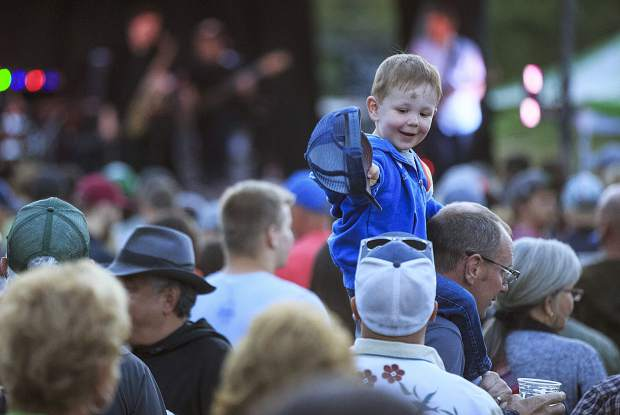 Avery Class, 2, of Silverthorne, interacts with family during a free concert at the annual Colorado BBQ Challenge Thursday, June 15, on Main Street in Frisco.
