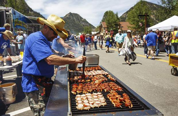 Golden Toad cook Bill Rendeck marinates the kebabs during the annual Colorado BBQ Challenge Friday, June 16, on Main Street in Frisco.
