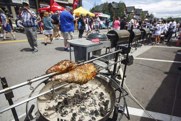 Meats cook-off in front of crowds on Main Street during the annual Colorado BBQ Challenge Friday, June 16, in Frisco.