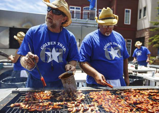 Golden Toad cooks fry off the kebabs during the annual Colorado BBQ Challenge Friday, June 16, on Main Street in Frisco.