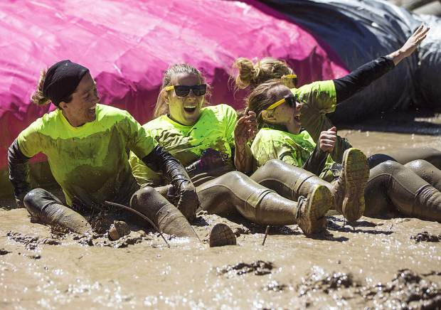 Neon-hued mud runners slide into one of more than a dozen mud pits at the 2017 Dirty Girl Mud Run in Copper Mountain on June 10. The event drew hundreds of female runners from across the state and globe for a 5K benefit to support Boarding for Breast Cancer, a California nonprofit that pairs breast cancer survivors with snowboarding, skateboarding, surfing and mud running.