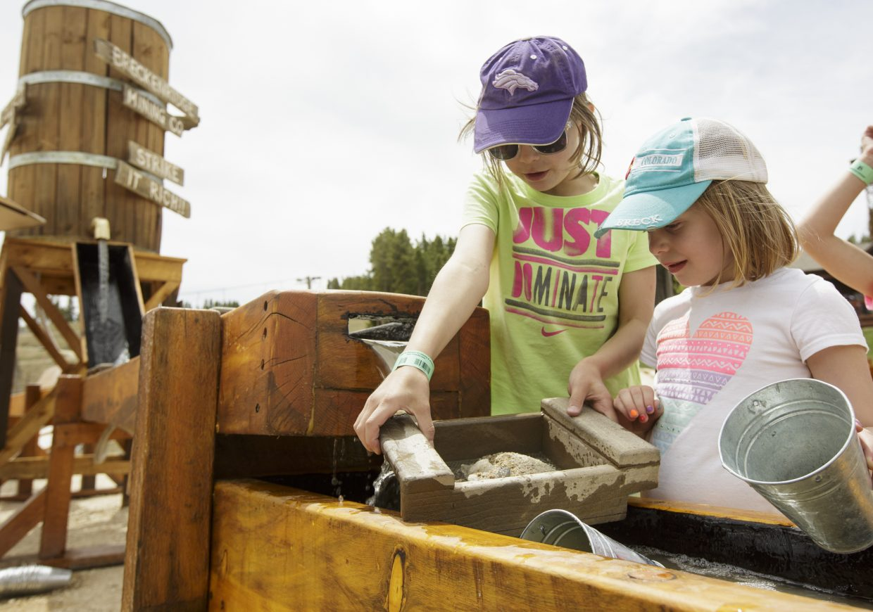 Krissy Stoyanova, 10, of Breckenridge, left, and Avery Andrus-Lundy, 5, of Castle Rock, use the tools in the
