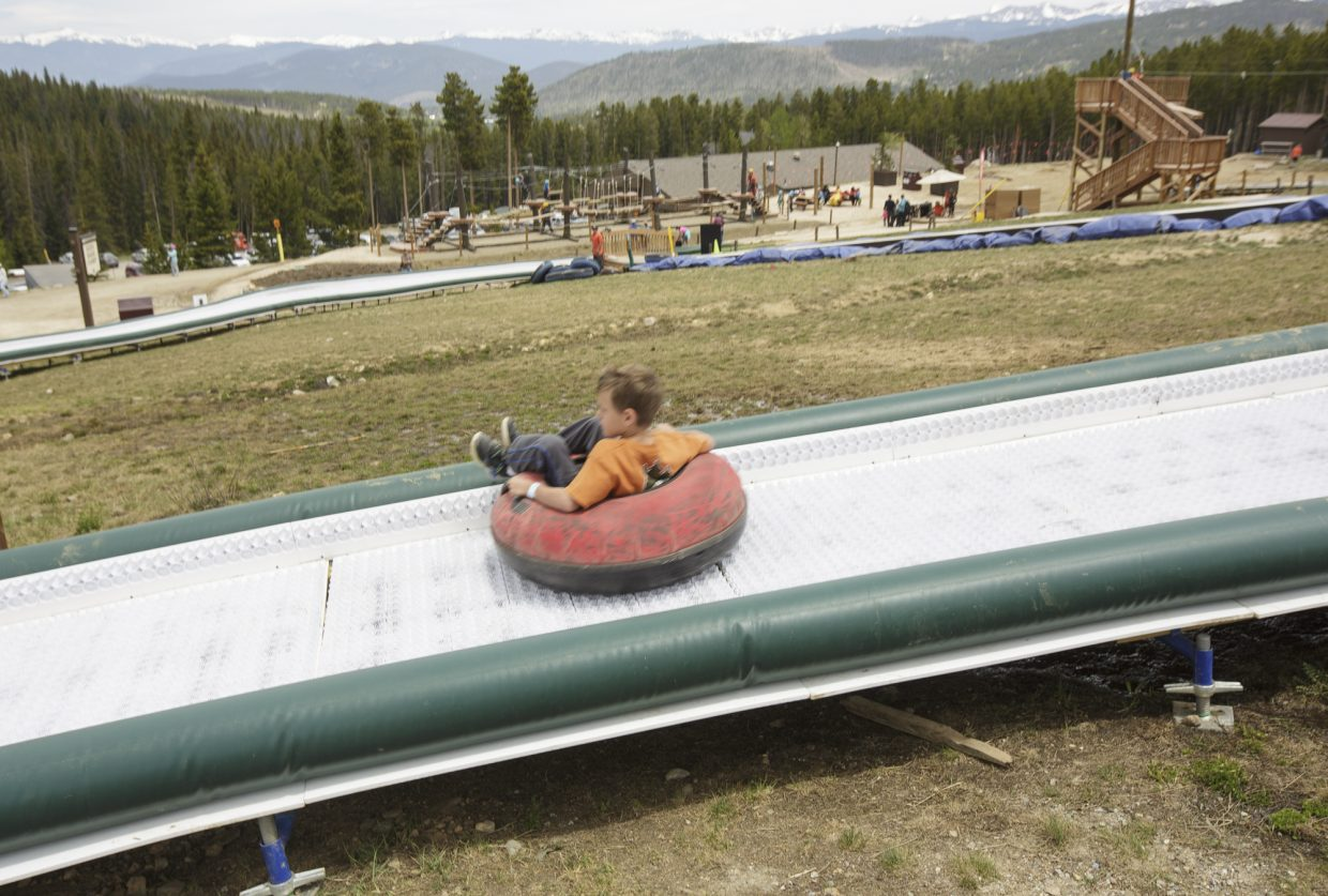 A boy zips by on a tube during the opening day of the Epic Discovery summer theme park Friday June 9, on Breckenridge Ski Resort.
