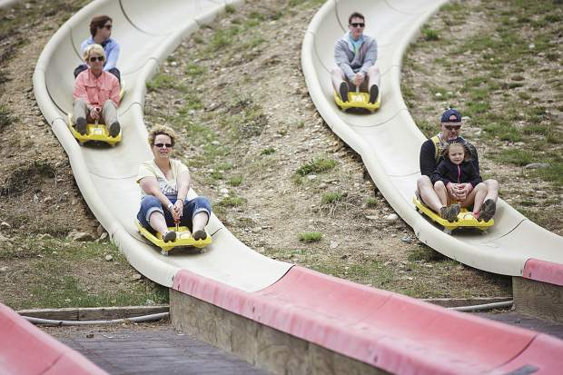 Guests of all ages ride down the