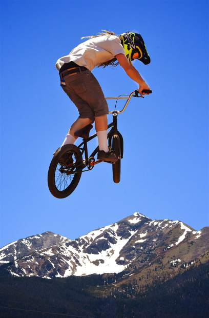 Danny Peirce of Breckenridge hangs over Peak One during the Frisco Bike Fling jump jam on June 24. More than 20 riders came for the free jump jam and dual-slalom races.
