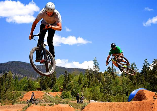 A duo of bikers rolls in sync through the Frisco Bike Park jump line during the Frisco Bike Fling on June 24. More than 20 riders came for the free jump jam and dual-slalom races.