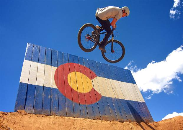 A rider pops off the Colorado flag wallride during the Frisco Bike Fling at the Frisco Bike Park on June 24. More than 20 riders came for the free jump jam and dual-slalom races.
