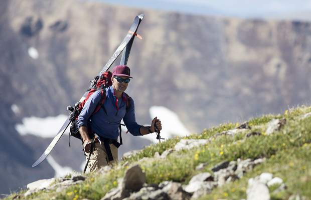 Summit County resident Gary Fondl, 50, hikes towards Grays Peak amid blooming wildflowers in the sub-alpine environment Thursday, June 29, near Montezuma.