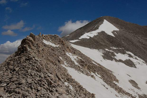 A view of the ascent trail crossing the final ridge to the summit of Mount Antero (14,269 feet), approaching from the south in early summer.