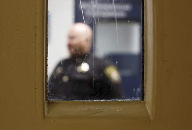A worn door window from inside a holding cell at the Summit County Jail Wednesday May 31, 2017, in Breckenridge.