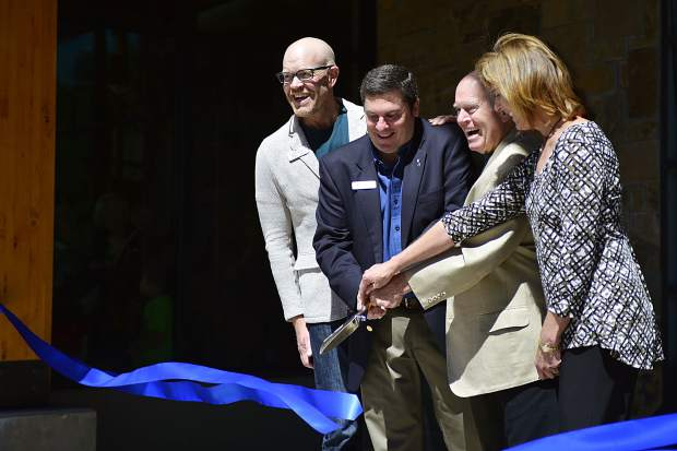 From left, Summit County Commissioner Thomas Davidson, Silverthorne Mayor Bruce Butler, president of the Lake Dillon Theatre Company board of directors Larry Kelly and state Rep. Mille Hamner cut a ribbon during Saturday's grand-opening ceremonies for the new $9 million Silverthorne Performing Arts Center. Together they served as the keynote speakers.