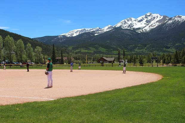 Summit's fielders prepare for the play in the first game of a doubleheader on Saturday against the Carbondale Cowboys.