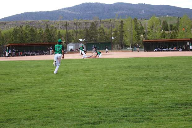 Summit's shortstop applies the tag at secondbase during the second inning of Tuesday's game against the GameDay Saints.