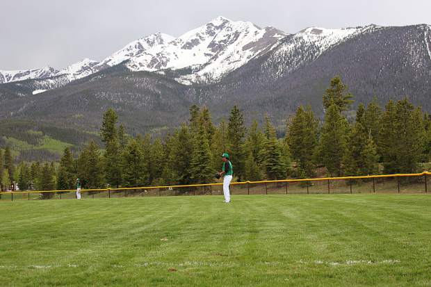 Summit's outfileders prepare for the play in the shadow of Peak One in Frisco on Tuesday.
