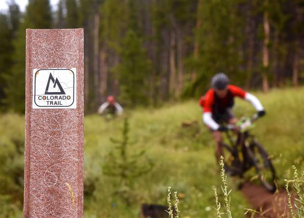 Riders weave along the final stetch of the Colorado Trail during the Breck 100 on July 29. The event drew nearly 300 riders from across the world for 32, 68 and 100 mioles of riding in constant rain and chilly temperatures.