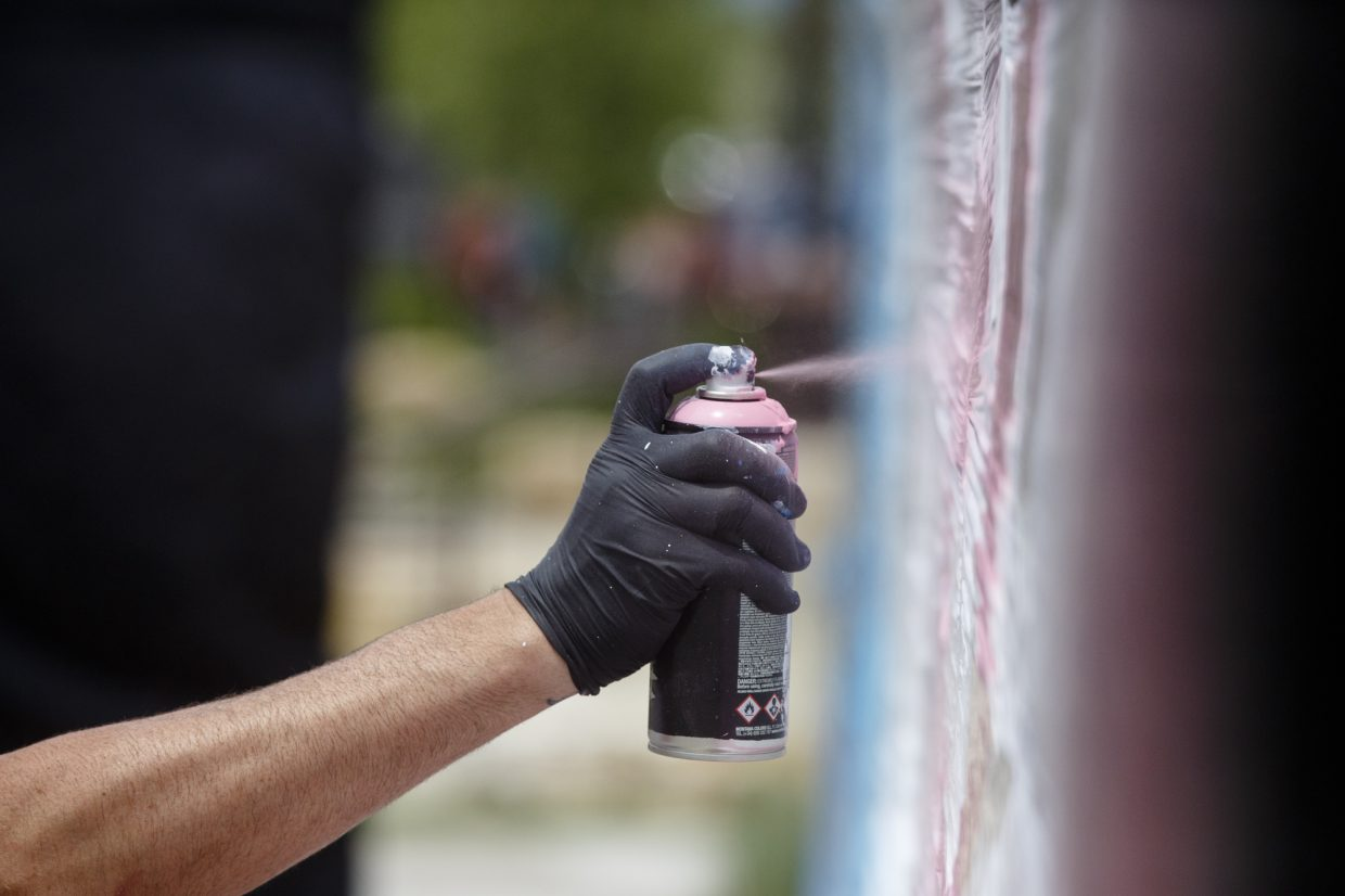 Artist sprays paint on a mural during the Street Art Festival Monday, July 2, in Breckenridge Arts District. The free celebration of street and graffiti arts featuring outdoor murals, chalk installations, and performances is on display in the Breckenridge Arts District July 4 from noon to 4 p.m.