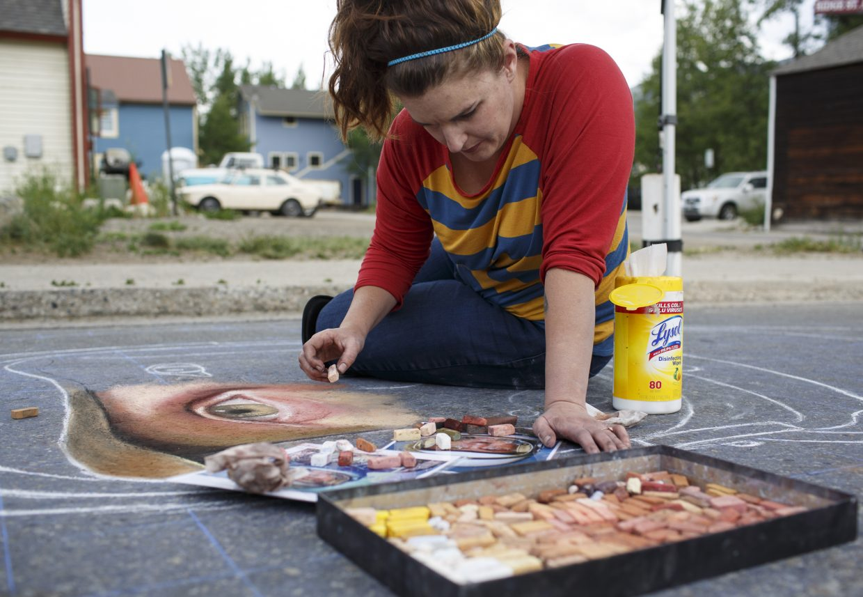 Artist Naomi Haverland works on chalk art during the Street Art Festival Monday, July 2, in Breckenridge Arts District. The free celebration of street and graffiti arts featuring outdoor murals, chalk installations, and performances is on display in the Breckenridge Arts District July 4 from noon to 4 p.m.