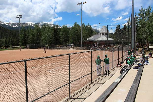 The Summit coaches and bench look on as the team bats in Thursday's first game against the Grand Junction Rocky Mountain Oysters.