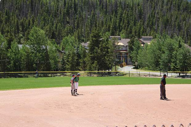 Summit center fielder Cody Minnis stands on second after a double in the sixth inning of Thursday's first game against the Grand Junction Rocky Mountain Oysters.