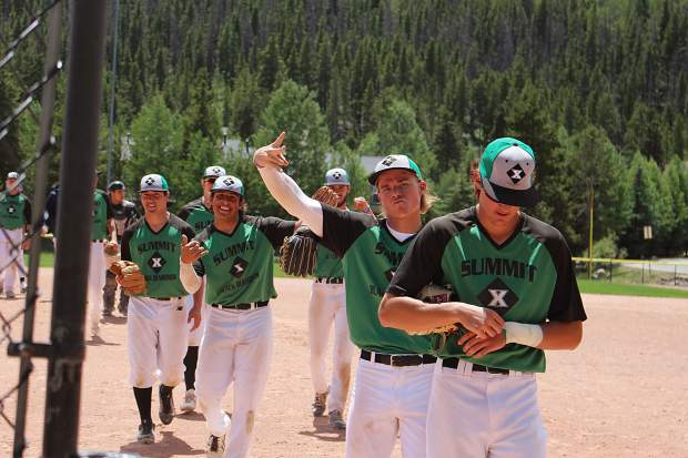The Summit Extreme Black Diamonds celebrate after beating the Grand Junction Rocky Mountain Oysters, 7-5, in the first game of Thursday's doubelheader.